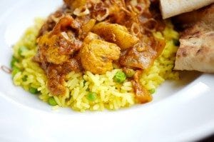 Meat on yellow rice with pita bread