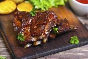 Appetizing rosy and barbecued lamb ribs seasoned