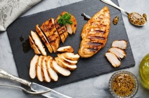 Chicken made with American Griddle on a black cutting board