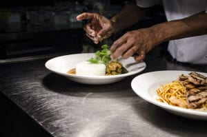 Chef preparing several plates of food