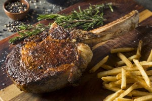 Cooked Grass Fed Tomahawk Steaks made with Steam Shell Technology