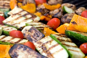 Various grilled vegetables like bell peppers, tomatoes, mushrooms, etc.