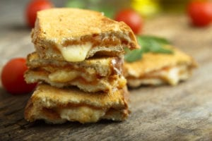 Stack of grilled cheese sandwich slices