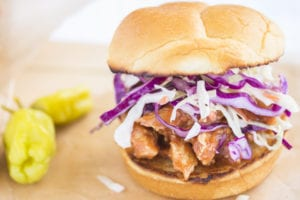 Hawaiian BBQ chicken sandwich with purple cabbage