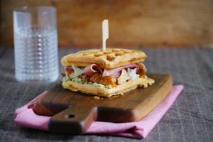 Monte Cristo waffle sandwich with prosciutto, chanterelles and cream cheese meal